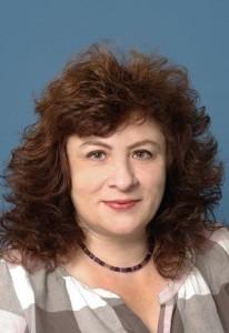 Профессор Лела Мигирова